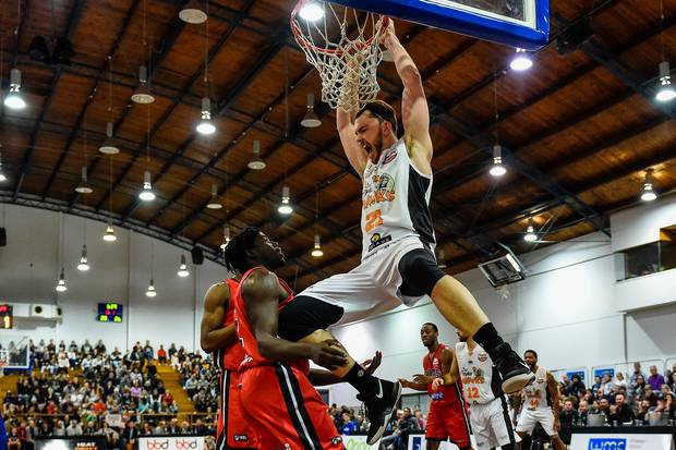 Hawks Australian import centre Angus Brandt dunks the ball
